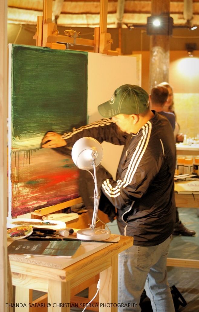 Agustin Gonzalez working on a painting