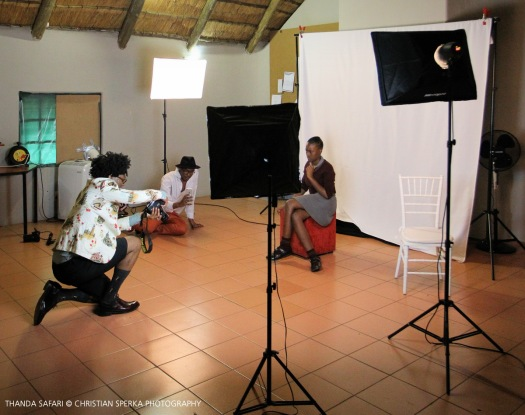 Ike Ude taking Star For Life school students images at the Intibane photo studio