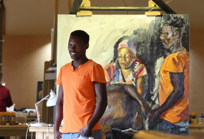 A young Zulu model in front of the group portrait which he is part of